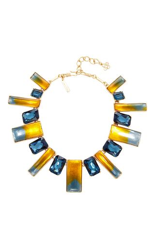 Mixing resin and glass beads, this **Oscar de la Renta** necklace exudes artistic elegance.