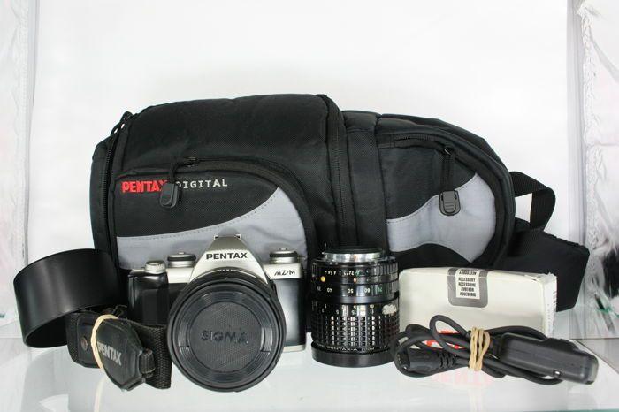 Pentax MZ-M met Pentax-A zoom 35-70mm f4 en een Sigma 70-210mm f4-5.6 een Pentax slingback cameratas en accessoires (2526)  Deze set met een Pentax MZ-M kleinbeeld camerabody een Pentax-A zoom 35-70mm f4 objectief een Sigma 70-210mm f4-5.6 objectief een Pentax slingback cameratas een ontsnapkabel en een Hama UV390 (0-Haze) M58 (IV) filter is een heel complete set. De set is overal in goede staat de camera en de objectieven hebben wel de gebruikelijke gebruikerssporen welke zichtbaar zijn op…