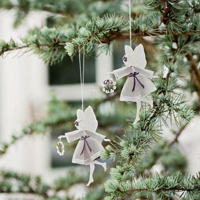 A delicate pair of gift boxed fairies. Laser cut metal and paper designed by Denmark Jette Frolich.