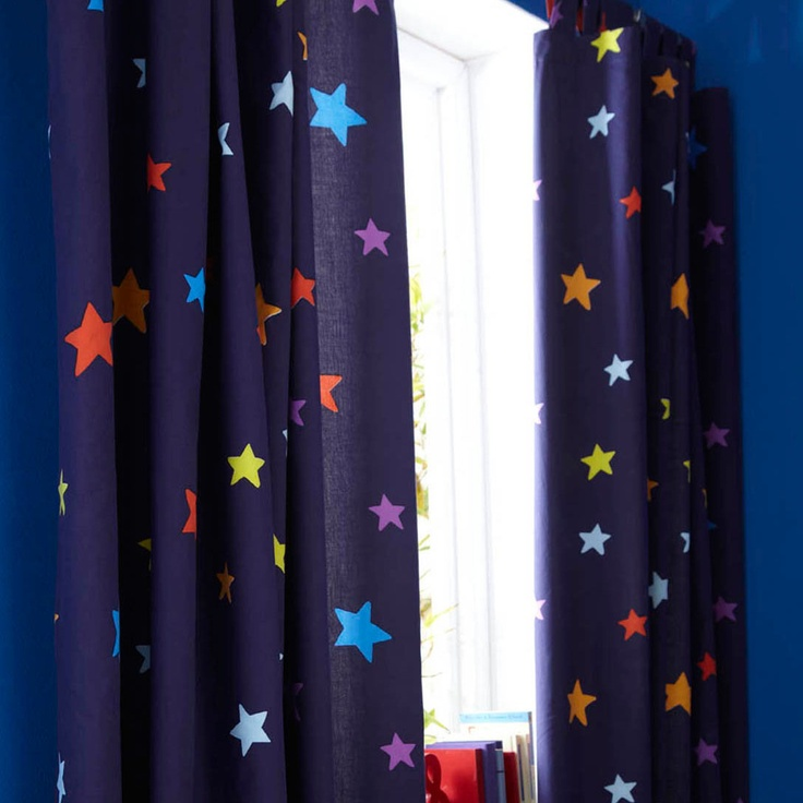 Navy blue curtains with a multicoloured star print.  http://www.worldstores.co.uk/p/Catherine_Lansfield_Outer_Space_Curtains.htm