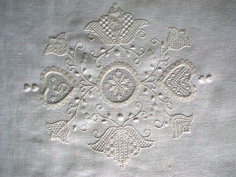 Schwalm embroidery (Germany) - It combines drawn thread work, pulled thread work, and whitework. The motifs are generally bold, folk motifs – tulips, hearts, flowers, birds.