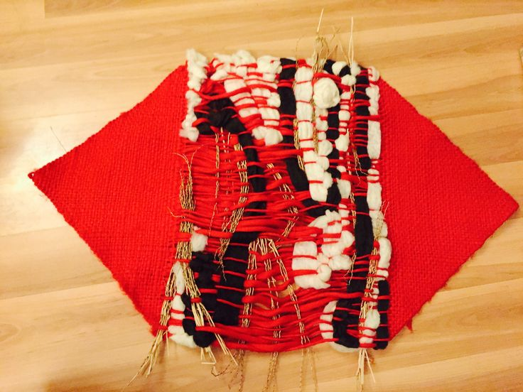 Loom in mixed media, with rustic wool, felt and applications and branches of palm seeds.