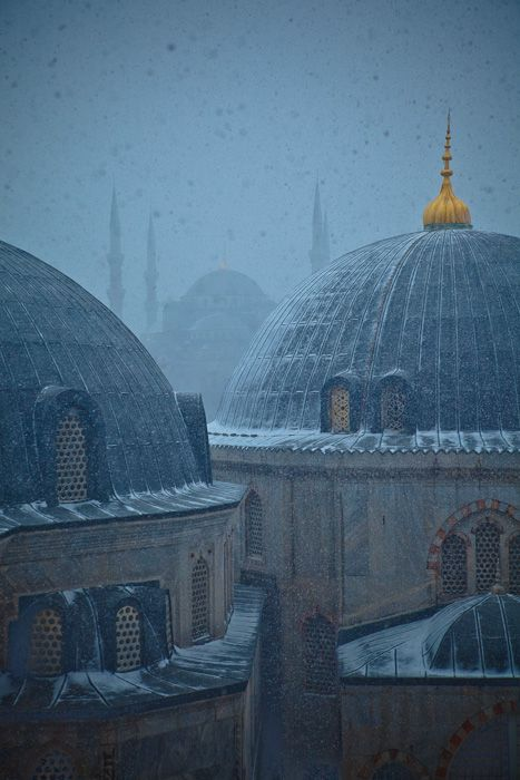 The Aya Sophia with the Blue Mosque in the background on a snowy morning.