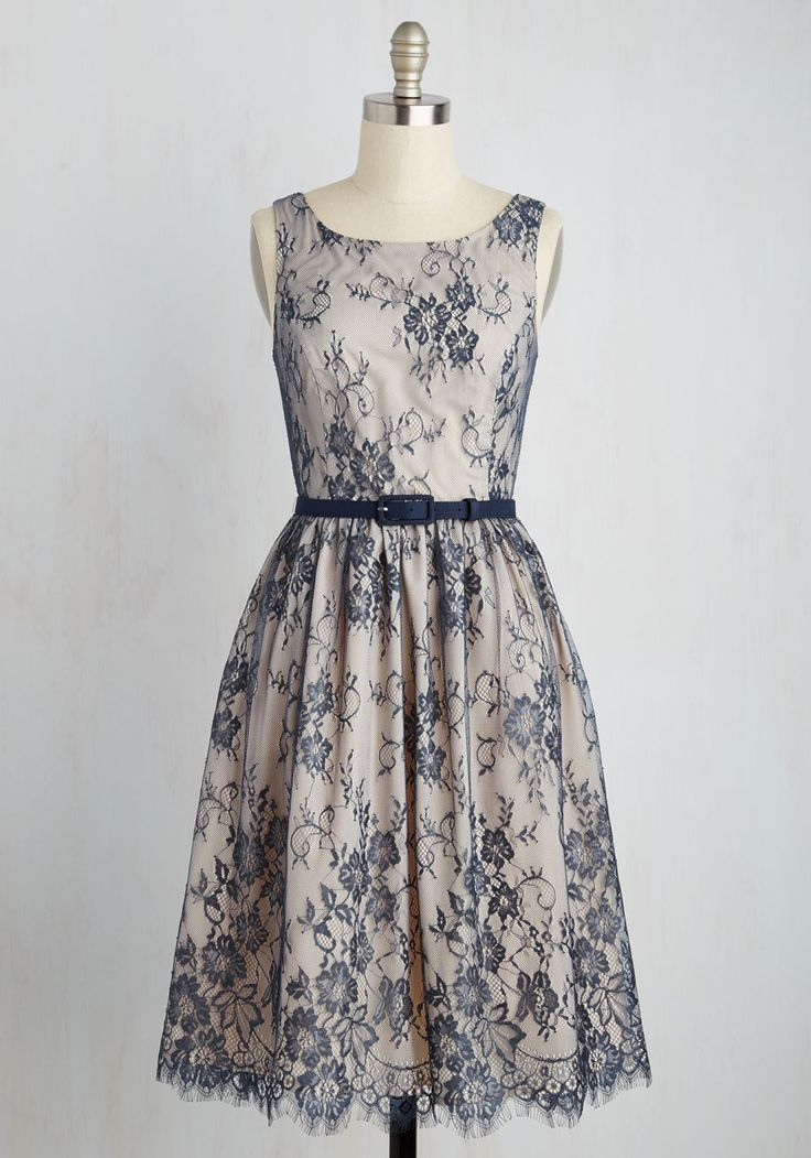When it comes to loveliness  this lace  A line dress puts you far ahead of the game  A glamorous part of our ModCloth namesake label  this navy veiled number is graced with a floral design  a belted waistline  and scalloping along its hem  Lined with an ivory hue  it  39 s the picture of pretty  indeed