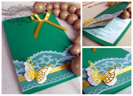 Wedding invitation card on colored cardboard with colored ribbons and lace.