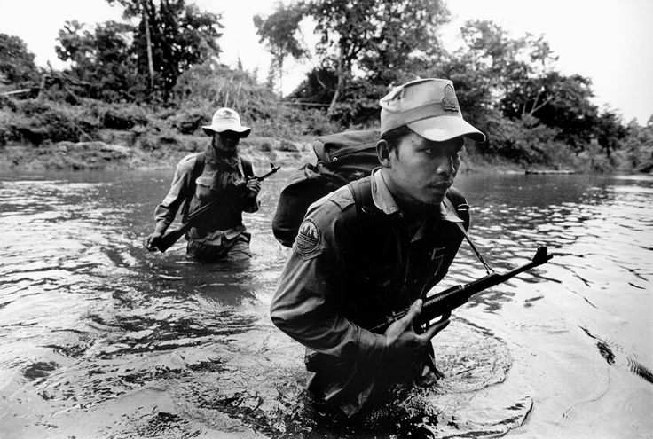 Picture of Cambodian forest rangers crossing a river