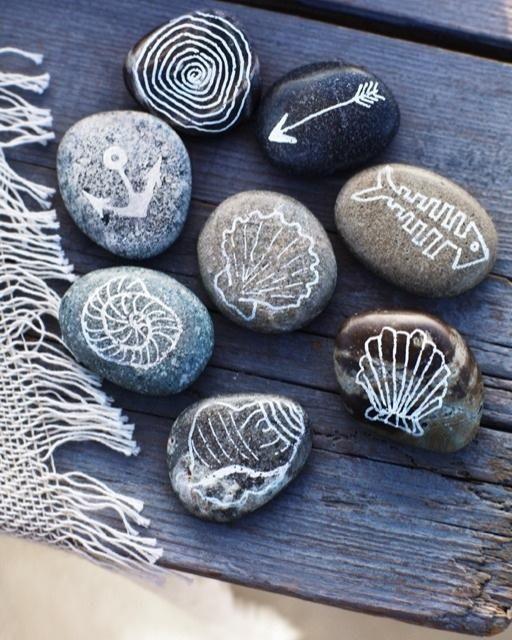 Nautical Rock Souvenirs: Gather pretty, smooth rocks. Draw local motifs on the rocks with a paint sharpie.