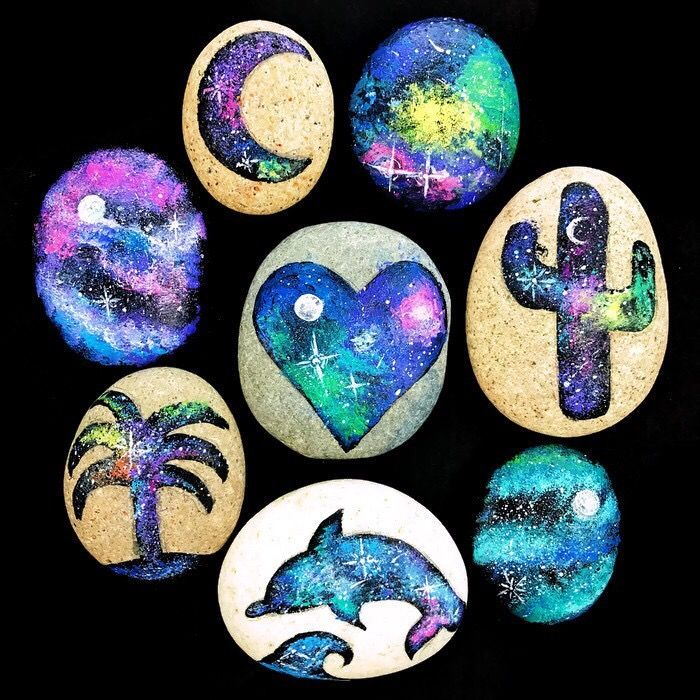 Lately, I've been obsessing over pretty galaxy art, and I thought it would be fun to take that same concept and apply it to painted stones. I have to say that although it may look complicated, this is one of the easier rock painting DIYs I've tried. You don't have to be super artistic to achieve a beautiful painted rock. You can make your own galaxy painted rocks with just a few simple steps and supplies.