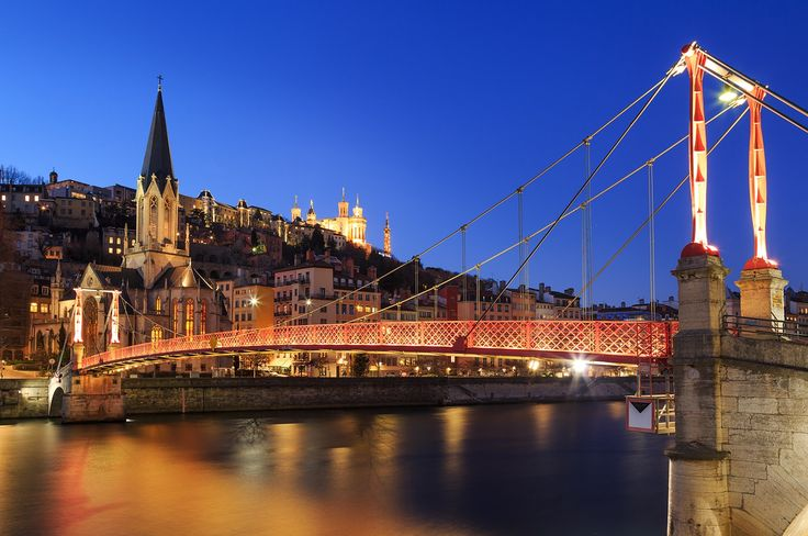 """Passerelle Saint Georges - Illuminated Passerelle Saint Georges footbridge and Vieux-Lyon with Fourviere cathedral in Lyon, France, at dusk.  If you like my work, you can follow me at <a href=""""https://www.instagram.com/sandervdw/"""">INSTAGRAM </a> for a near daily feed."""