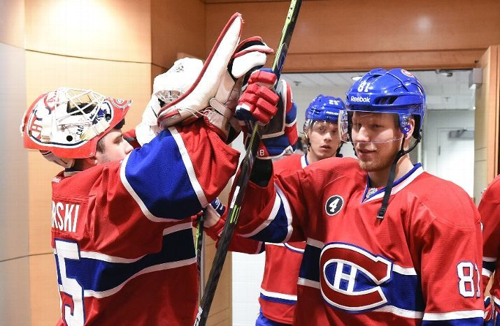 MONTREAL, QC - FEBRUARY 14: Dustin Tokarski #35 and Lars Eller #81 of the Montreal Canadiens before the NHL game against the Toronto Maple Leafs at the Bell Centre on February 14, 2015 in Montreal, Quebec, Canada. (Photo by Francois Lacasse/NHLI via Getty Images)