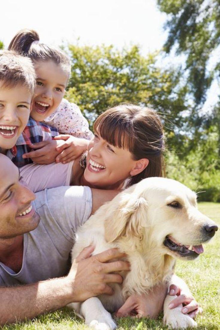 Family relaxing in garden with pet dog goldenretriever