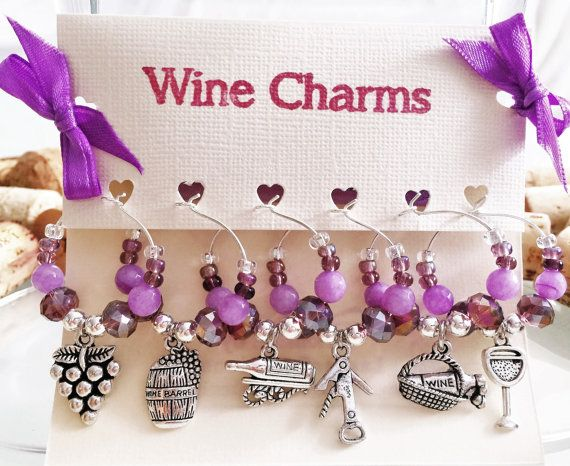 Check out this item in my Etsy shop https://www.etsy.com/listing/455070760/wine-charms-set-of-6-purple-wine-charms