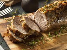 Recette de Rôti de porc à l'ail et au thym, rattes au four