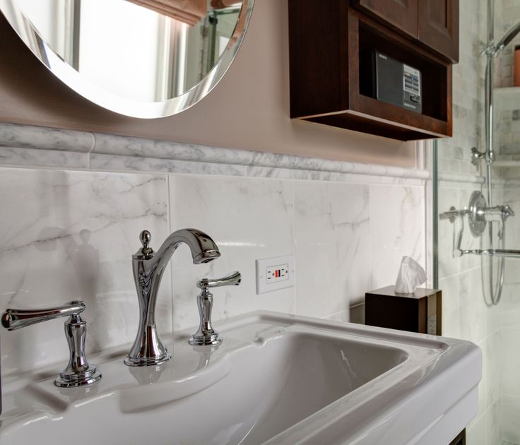 the faucet in this bathroom is a chrome charlotte faucet from brizo against the wainscot tile that looks like marble the combination is very dramatic - Bathroom Accessories Chicago