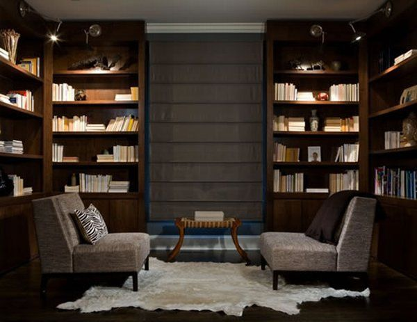 modern library in home with gray furniture