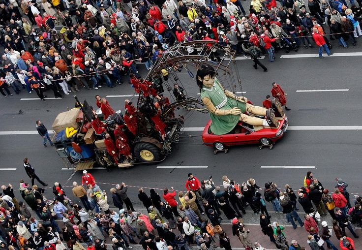 A giant girl marionette is led through the streets of Berlin, on October 2, 2009.