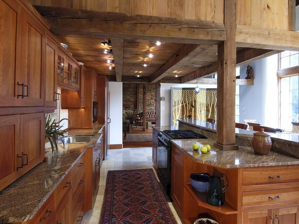 """I think I enjoy kitchens with lower ceilings that open up to higher spaces because it gives a """"bar"""" feel to the kitchen area, and I love entertaining!"""