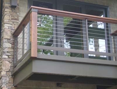 tension cable railing - idea for the divider between the kitchen & the sun room.