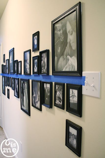 A good way to hang pictures on a long wall. Also has a good tool to use to hang instead of nails. gallery wall ideas gallery wall layout #design