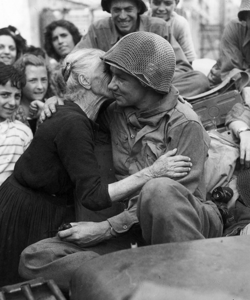 Old Italian Lady kissing a US soldier on the liberation of Rome.