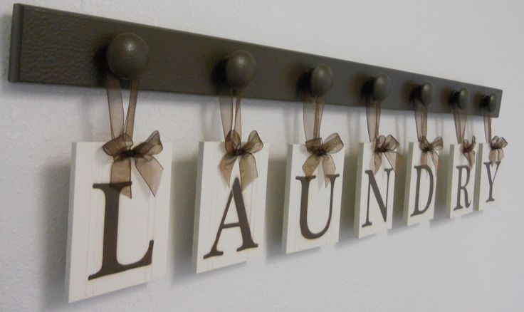 Laundry Room Decor Personalized Hanging Wall Letters includes 7 Wooden Peg Hangers and Letters LAUNDRY in Chocolate Brown by NelsonsGifts on Etsy https://www.etsy.com/listing/79736479/laundry-room-decor-personalized-hanging