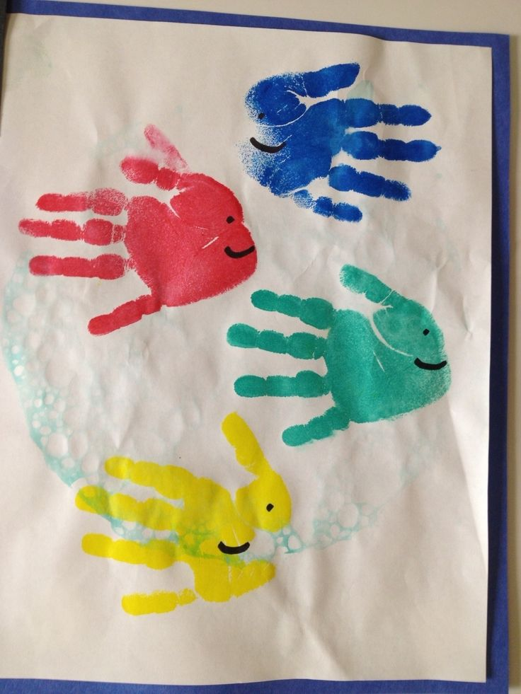 """Some KinderCare toddlers created a hand-print art project after they read """"One Fish Two Fish Red Fish Blue Fish"""" by Dr. Seuss. Ages: Older Infant, Toddler, Preschool, PreK"""
