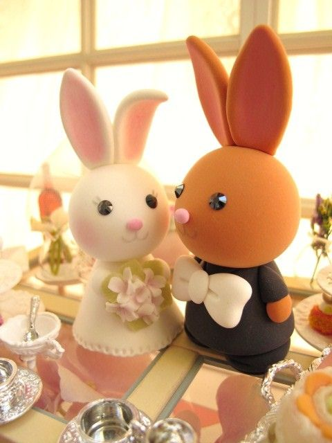 LOVE ANGELS Wedding Cake Topper-love rabbit and bunny with sweet heart base and swarovski crystal. $130.00, via Etsy.