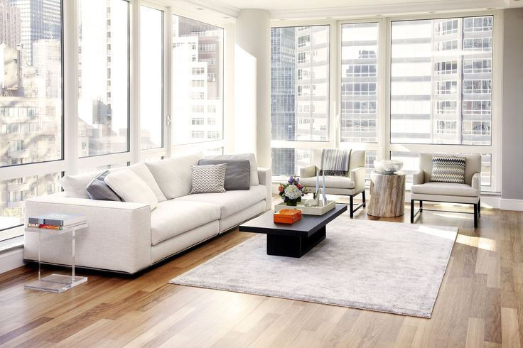 Beautiful modern condo living room designed by Tara Benet Design. We love how the designer had used almost all light colour furniture for this space.