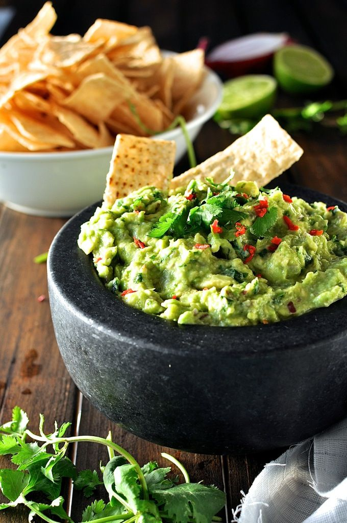 This is is the best ever authentic guacamole recipe! The secret step that makes this so special is mashing some of the red onion in a mortar and pestle before adding the rest of the ingredients - the flavour of the paste mixed throughout the guacamole really takes this to another level!