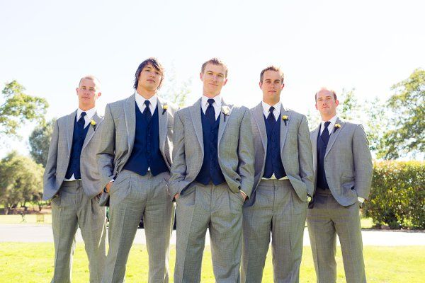 We're doing grey/navy for best men, grey w/ coral vest and navy tie for me, and grey with navy vest and coral tie for tray