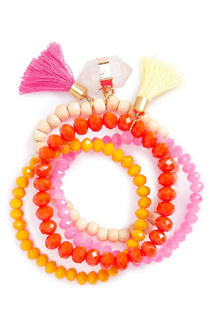 Bright crystals and beads in lively hues of pink, orange and red add a splash of color to the wrist. These will look adorable stacked or worn alone for a boho-chic look.