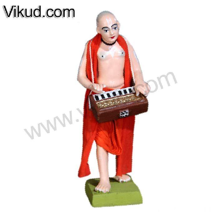 Terracotta-Rajasthani Saffron Brahmacari Playing Harmony Doll- (7 Inches)