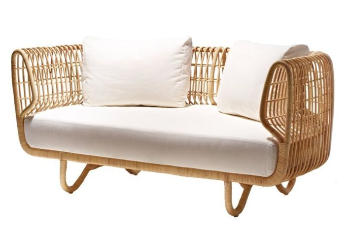 "Cane-Line's Nest indoor rattan furnishings designed by Foersom & Hiort-Lorenzen and crafted in Indonesia -- footstools, lounge chairs and sofas available with cushions in different colors. .. great in the patio or sunroom. Despite their light weight, the Nest collection is highly durable. [Ck--if it's ""indoor"" furniture, how does it work on a patio?]"