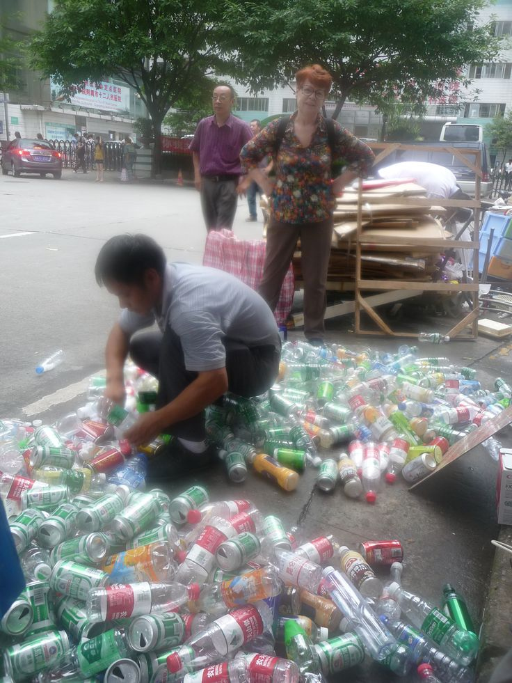 Selling empty bottles on the 'footpath recycling centre' to support poor children in Nepal. Miss Tove's English School can sell enough empty bottles to sponsor 2 poor children's education each year.