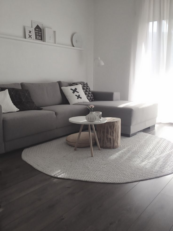 living room - Grey lounge room. I like the coffee table teamed with the wooden stool and big floor pillow