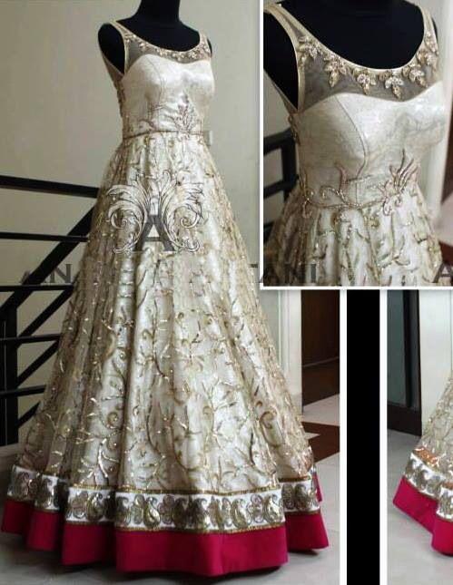 Cream bridal lehenga with maroon border at bottom.  #bridallehengadesigns #lehengadesigns #indianweddinglehenga