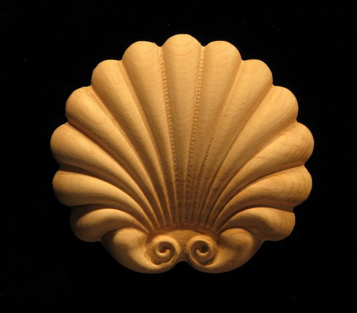 This shell form features decorative scroll elements and can be sized to suit requirements for application to a flat surface.