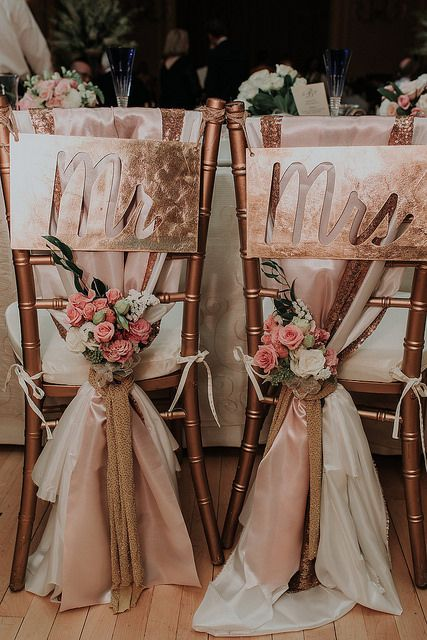 """Specially decorated """"Mr. & Mrs."""" chairs for the bride and groom at Ashley and Patrick's wedding at DuPont Country Club. Kelli Wilke Photography."""
