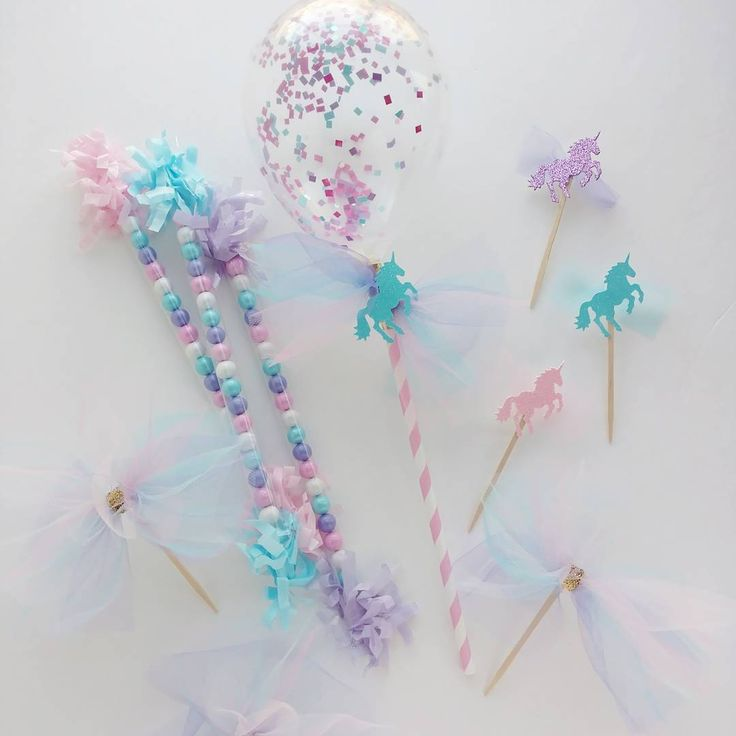 This is going to be one sweet unicorn birthday party! ❤💙💜 Confetti balloon wands with tulle and unicorn: $3 each. Candy wands: $1.50 each. Mini glitter unicorn cupcake toppers: $0.75 each. Tulle pouf cupcake toppers: $1.25 each. Order via email in profile. #handcraftedparties #unicornparty #pastels #tulle #cupcaketoppers #candywands #sixlets #unicorns #unicorncupcake #balloonwands #miniballoons #confettiballoons