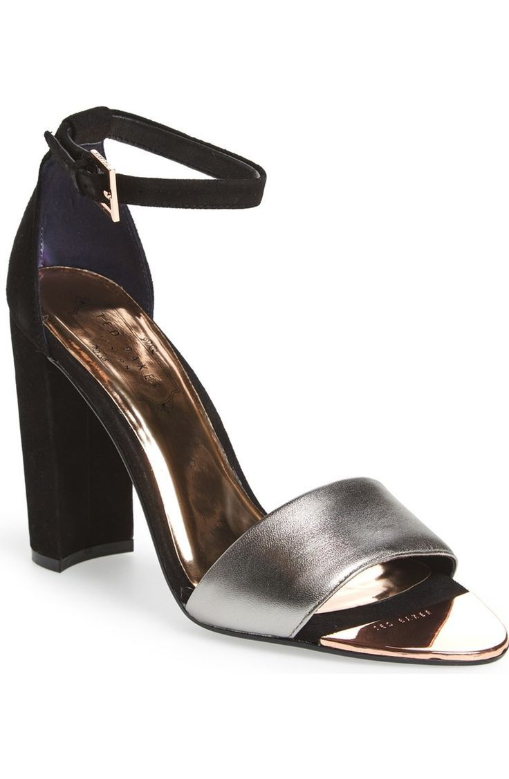 The asymmetrical toe strap of this shimmery metallic leather sandal from Ted Baker combines with a barely there ankle strap to complete the showstopping look.