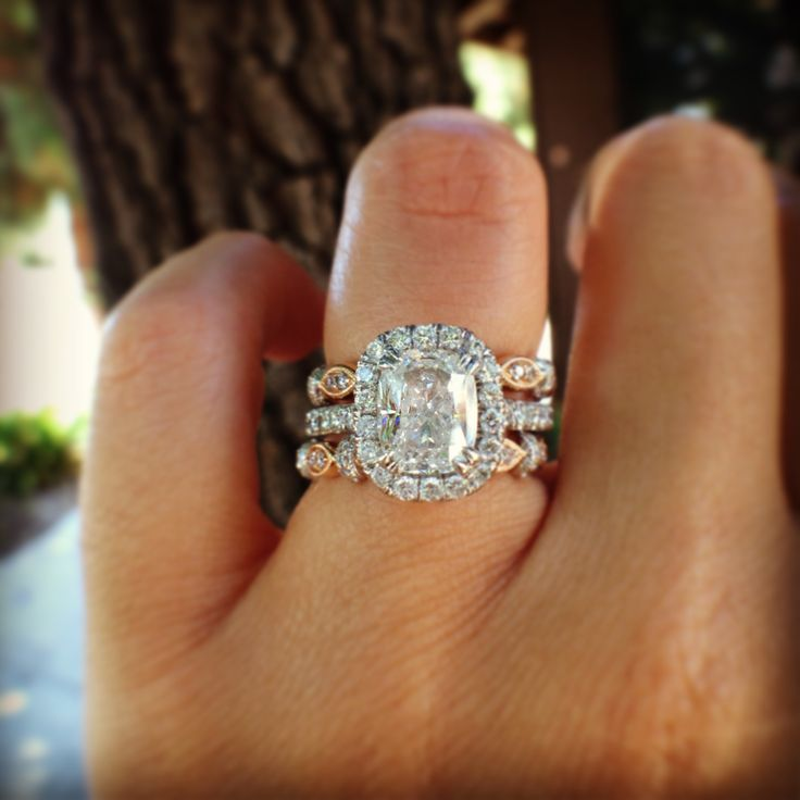 Kirk Kara Cushion Halo Engagement Ring With Cut Center Stone Guarded By Two Rose Gold Wedding Bands
