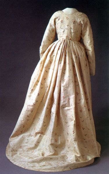 """This dress, 1795-1800, is sewn from a striped silk fabric with rosebuds from the 1770s. Traces of stitches show that the fabric was previously used in a robe à la française. In the 1790s many old dresses were modernized to fit the new fashion. """"I went to Mrs. Molzer, we went together to Ladugårdslandet to a Miss Liljenstråle, who sews ladies clothes and I left there a piece of silk fabric that I got from Uncle Pohnsen 1775, as a wedding gift, but kept until now, when everything old is…"""