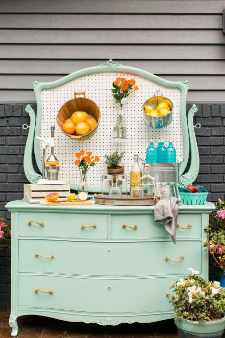 Add+buffet-style+entertaining+to+your+outdoor+space+with+a+repurposed+dresser+turned+into+a+clever+sideboard.+This+old+wooden+dresser+was+updated+with+mint+paint,+and+the+mirror+was+swapped+with+pegboard+to+keep+hosting+essentials+within+arm's+reach.+Make+Your+Own+>>