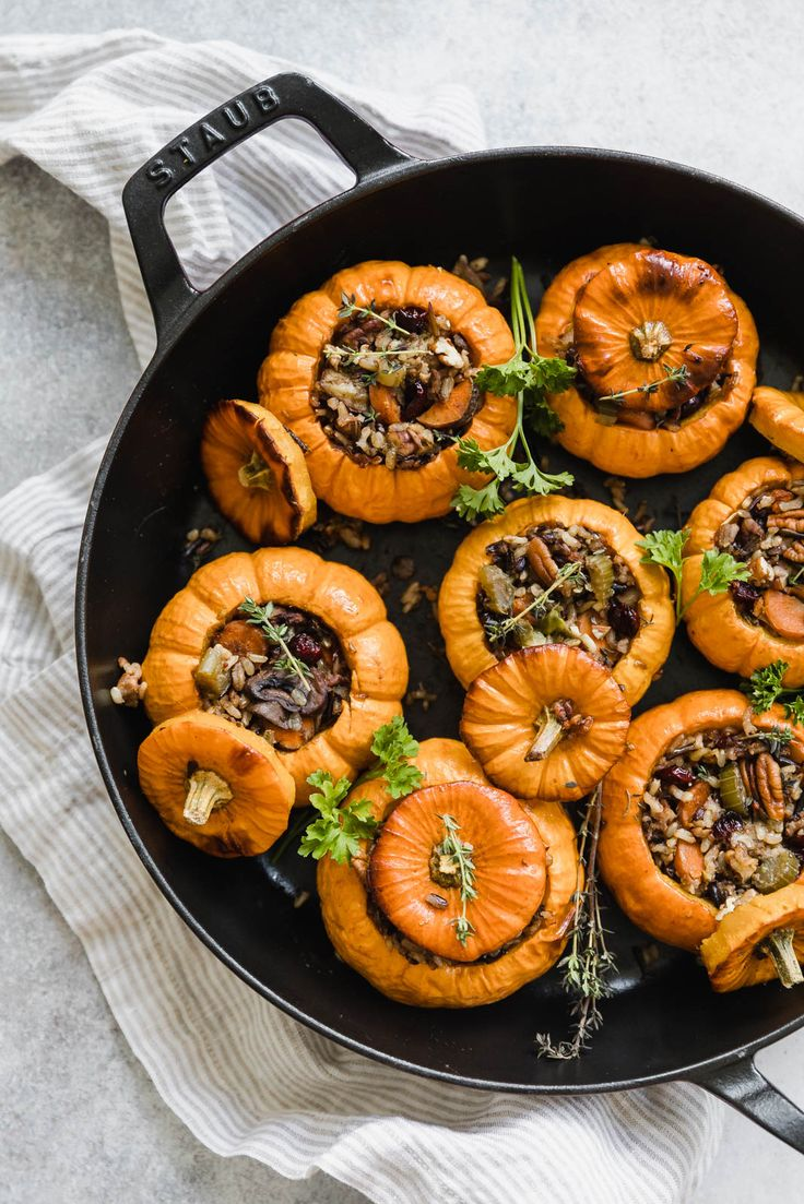 Mini wild rice stuffed pumpkins chock full of fall vegetables, pecans, and cranberries. The result: a completely edible stuffed pumpkin bursting with flavor. // Broma Bakery