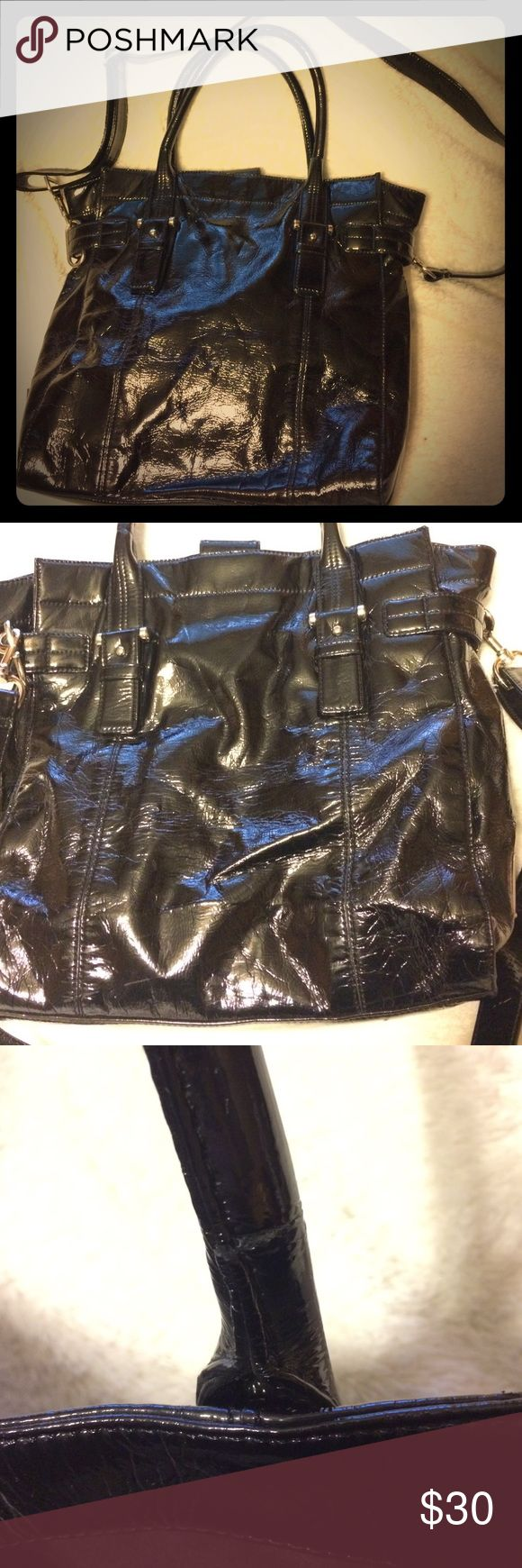 """Anne Klein Big Black Purse This 100% polyurethane purse has been preloved, but is still in great condition!  The only wrong with this bag is that the tubes in short handles have cracked, & so the handles are just starting to tear. The long adjustable strap is like new & so is the rest of the bag.  There are one or two tiny scuffs, but that's about it. It's a huge bag. The dimensions are 14"""" x 13 1/2"""" x 4"""" with short straps measuring 18"""" & long strap measuring about 51"""" fully extended…"""