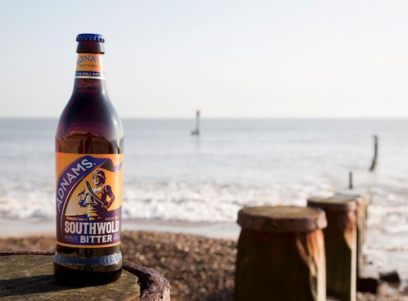 Adnams beer on Southwold beach# fresh sea air is regularly tinctured by fine malty clouds spilling out of the Adnams Sole Bay Brewery and wafting their way into town. And for many, that familiar smell of brewing beer will always evoke fond memories of a Southwold summer# History&Culture#