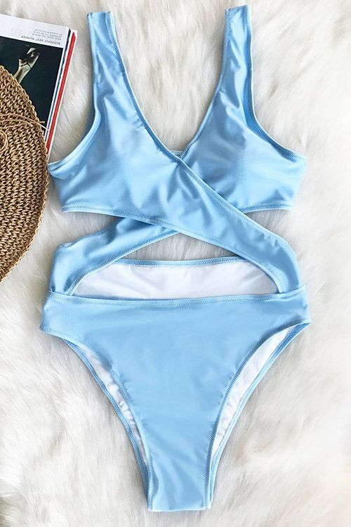 Live life on the beach. Don't stop there, wear this fabulous cross one-piece with your beach look to beach party and find out all of the ways to show this awesome piece. Free shipping! Check it out.