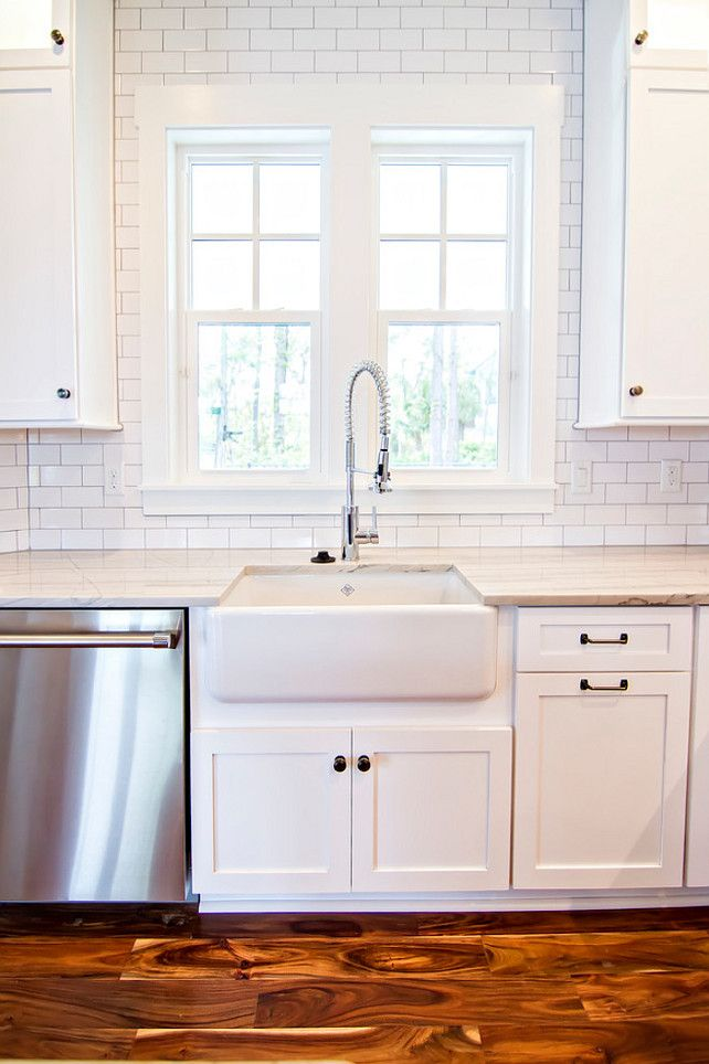 White Subway Tile Backsplash White Subway Tiles from counter to ceiling.  Glenn Layton Homes also love the farm sink!