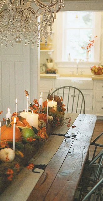 A gorgeous Thanksgiving table love the contrast crystal chandelier with primitive harvest