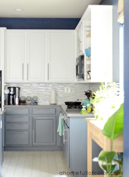 Benjamin Moore Simply White and Anchor Gray : A Home Full of Color did a whole kitchen makeover using Benjamin Moore Simply White on the upper cabinets, Benjamin Moore Anchor Gray on the lower cabinets, and Glidden Rich Navy on the walls. Such a great color combo! Head over to see all of the details (they have an enviable island sink and faucet!). Thanks, Shavonda! See more Benjamin Moore paint colors and Glidden paint colors.